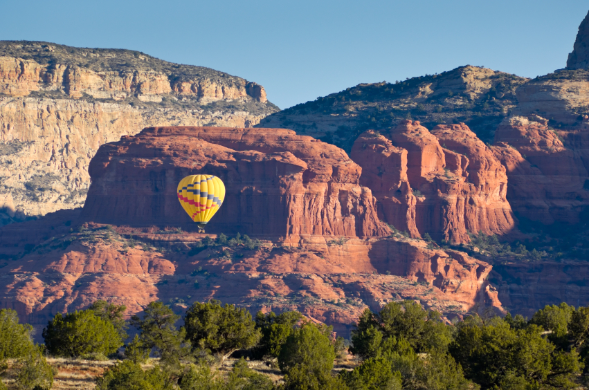 Hot Air Balloon Floating Through Scenic Canyon